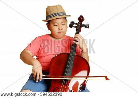 A Fat Asian Boy Wearing A Hat Wearing A Pink Shirt Playing Cello Music. Isolated