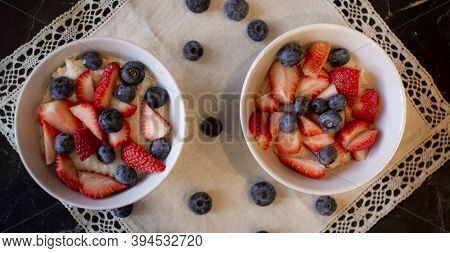Oatmeal Porridge With Blueberries And Strawberries.delicious Oatmeal With Berries In A Bowl On The T