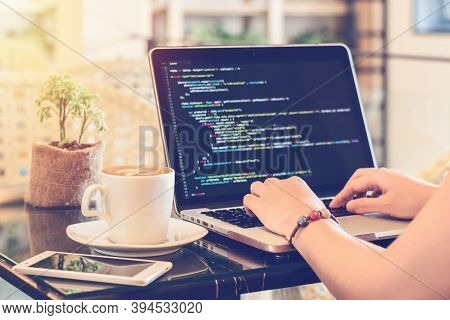 Programmer Typing New Lines Of Html Code. Laptop And Hand Closeup. Working Time. Web Design Business