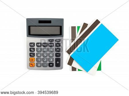 Saving Account Passbook And Green Power Office Desktop Calculator With Solar Cell Power Isolated On