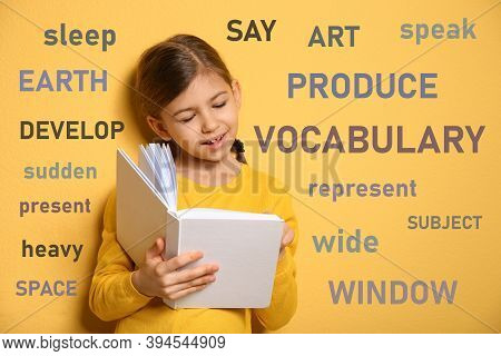 Cute Little Girl Reading Vocabulary Surrounded By Different Words In English On Yellow Background