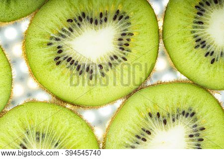 Top View Of Sliced Kiwi As Background