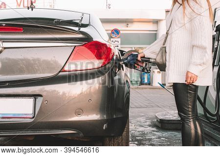 Refueling Car. Pump Gas At Petrol Fuel Station. Gasoline Oil Nozzle Tank From Hand Person. Automotiv