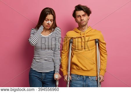Injured Woman And Man Being Victims Of Incident And Reckless Driving, Have Unhappy Expressions, Stan