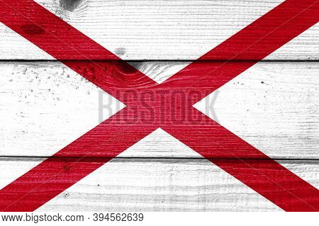 Alabama Flag Painted On Old Wood Plank Background. Brushed Natural Light Knotted Wooden Board Textur
