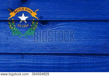 Nevada Flag Painted On Old Wood Plank Background. Brushed Natural Light Knotted Wooden Board Texture