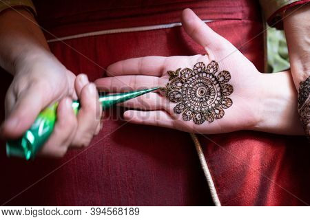 Top Down Video Of A Woman Copying The Mehndi Henna Tattoo From One Hand To The Other In Preparation