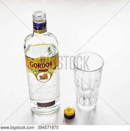 Moscow, Russia - November 4, 2020: Above View Of Open Bottle Of Gordon's London Dry Gin And Empty Gl