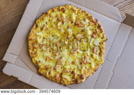 Hot Curry Pizza In Paper Box Close Up. Top View. A Delicious Butter Chicken Curry Pizza.