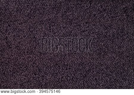 Dark Purple Fluffy Background Of Soft, Fleecy Cloth. Texture Of Violet Wool Textile Backdrop, Closeu