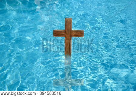 Wooden Cross In Water For Religious Ritual Known As Baptism