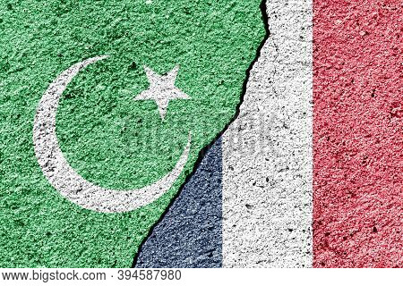 The Crack Between France And Islamic Flags. The Concept Of Islamic Conflict, Religios Crisis And Con