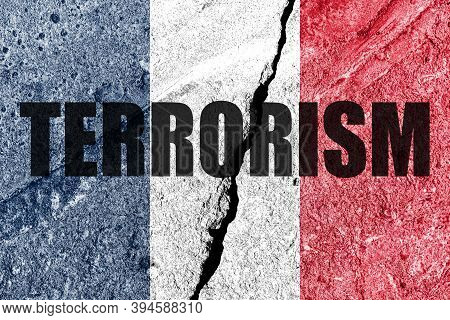 France Flag On Cracked Concrete Wall. The Concept Of Terrorism And Islamic Conflict In The Country.