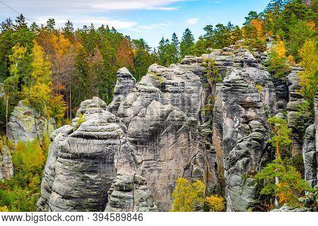 Prachov Rocks, Czech: Prachovske Skaly, Sandstone Rock Formation With Colorful Trees Of Autumn. View