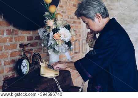 Old Asian Elderly Senior Elder Woman Dialing Telephone Number