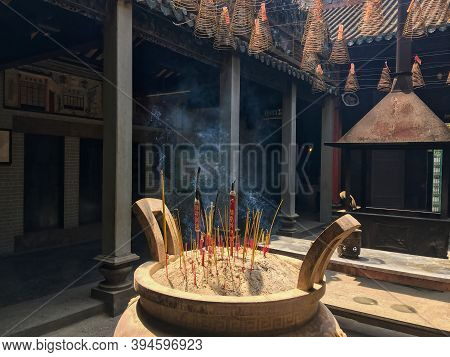 Burning Incense Or Joss Sticks For Offerings In Thien Hau Temple