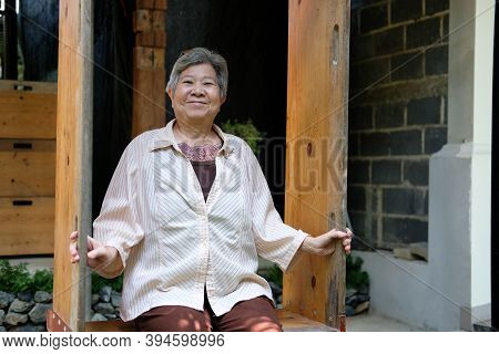 Elder Woman Resting At Home. Asian Elderly Female Relaxing Outdoors. Senior Leisure Lifestyle