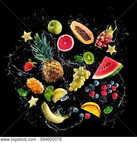 Assortment of fresh fruits and water splashes on black background. High resolution collage for print