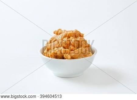 Crunchy peanut butter in white bowl