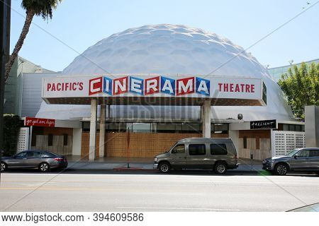 Hollywood, California / USA - November 10, 2020: Pacific's CINERAMA theater. Movie Theater in Hollywood California. Boarded up with Plywood due to Coronavirus and Potential Looting and Rioting.