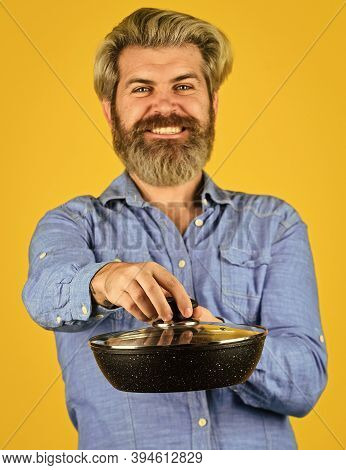 Cooking Food Concept. Hold Frying Pan. Best Quality. Bearded Cook Portrait With Kitchen Tools. Beard
