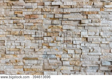 The Stone Wall Texture Background Natural Color. Background Of Stone Wall Texture Photo. Natural Sto