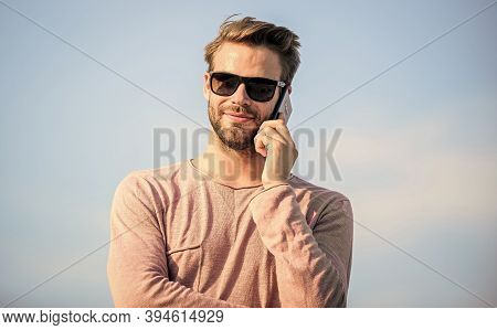 Pleasant Conversation. Confident Man Speak On Phone. Call To Friend. Macho Man Use Mobile Phone. Mod