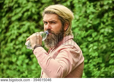 Safety And Health. Water Balance. Man Bearded Tourist Drinking Water Plastic Bottle Nature Backgroun