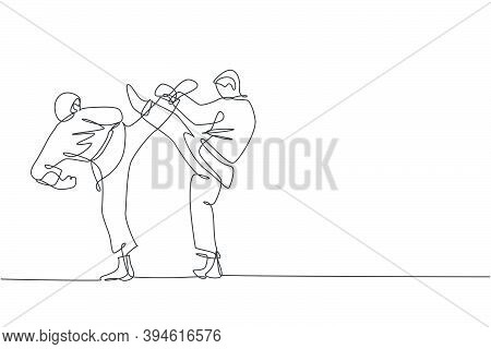 One Continuous Line Drawing Of Two Young Talented Karateka Men Train Pose For Duel Fighting At Dojo