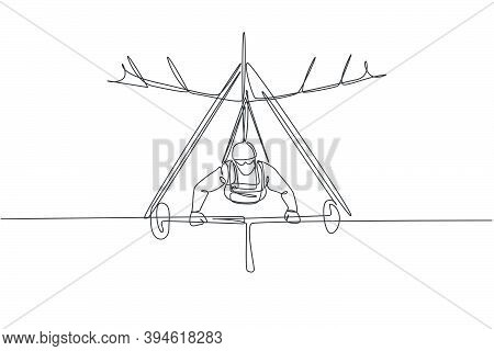 Single Continuous Line Drawing Of Young Tourist Man Flying With Hang Gliding Parachute On The Sky. E