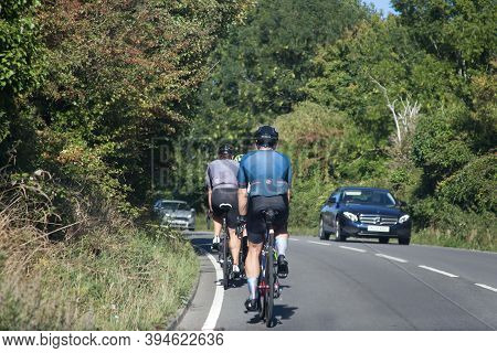 Cyclists Riding On The Road With Traffic In Dorset In The Uk, Taken On The 3rd Of August 2020