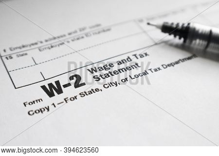 Tax Form W-2 For Employment Close Up With Fine Point Pen
