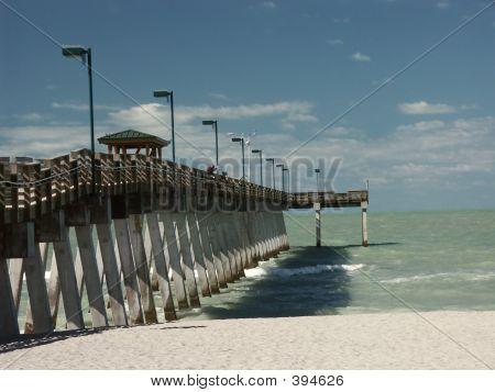 Fishing Off Pier On Ocean