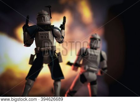 NOV 11 2020: Scene from Star Wars The Clone Wars with clone Captain Rex and troopers in battle - Hasbro action figures -  Focus on Capt. Rex
