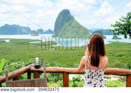 Happy Young Traveler Woman Raised Arm Take A Photo To Sky Enjoying A Beautiful Of Nature Samed Nang