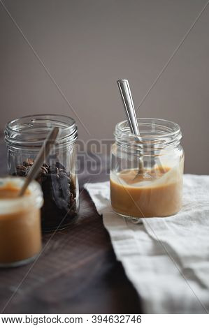 Coffee-flavored Yogurt Pudding Dessert In Glass Jar On Wooden Table. Healthy Lifestyle, Superfood