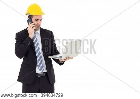 Architect Holding A Laptop Talking On The Phone With Copy Space