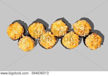 Baked Sushi Maki Isolated On Grey Background. Sushi Roll With Scallop, Salmon, Sesame Seeds And Unag