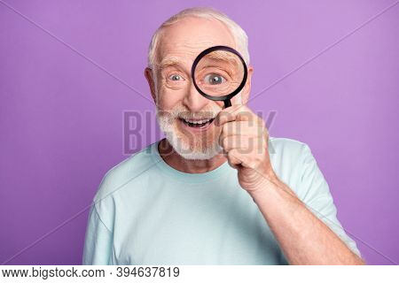 Close-up Portrait Of Cheerful Grey Beard Hair Pensioner Investigator Watching Through Loup Isolated