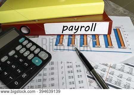 On Financial Documents With A Chart There Is A Folder Where Payroll Is Located. Business And Financi