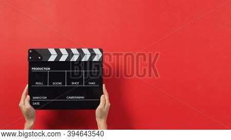 Hand Is Holding Black Clapper Board Or Movie Slate. It Use In Video Production ,film, Cinema Industr