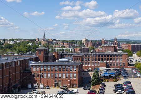 Manchester Historic City Skyline Including Amoskeag Mill Buildings And West Side Sainte Marie Parish