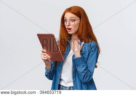 Touched And Impressed Redhead Tender Young Woman Watching Lovely Video Online, Looking At Something