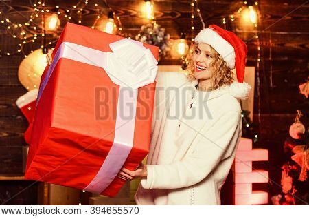 New Year. Really Big. Giant Surprise. She Deserves All Best. Girl Santa Hat Hold Enormous Gift Box.
