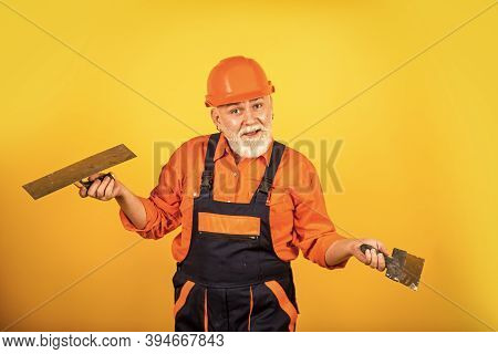 I Think I Can Help You. Plaster Trowel Spatula On Drywall Plasterboard. Plasterer In Working Uniform