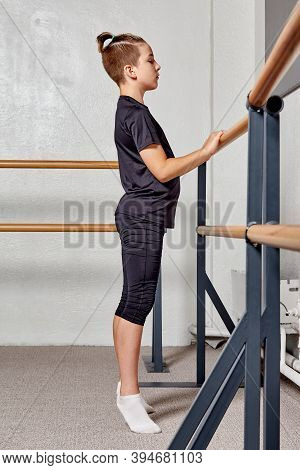 A Handsome Guy In The Gym Trains Ballet. Training In Ballet And Gymnastics.