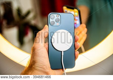 Paris, France - Nov 11, 2020: Man Hand Holding In Front Of Mirror New Iphone 12 Pro Max 5g Smartphon