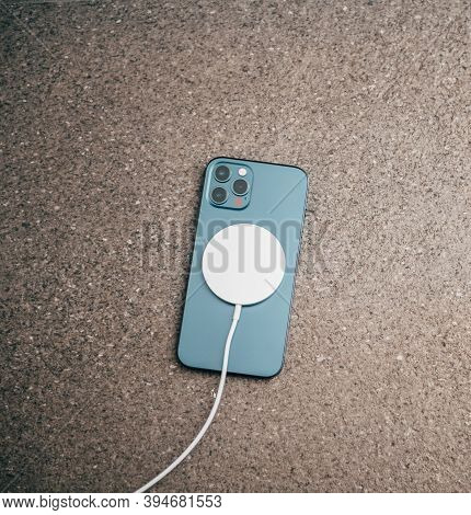 Paris, France - Nov 11, 2020: Charging With The New Magsafe Wireless Charger The Latest Iphone 12 Pr