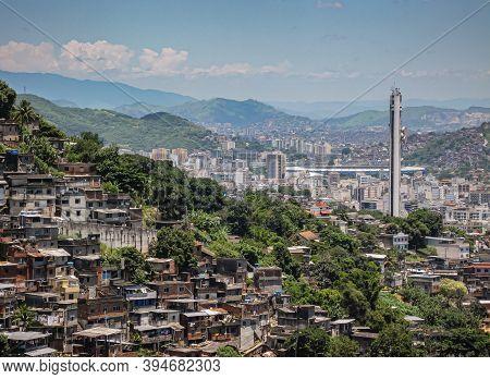 Rio De Janeiro, Brazil - December 24, 2008: Aerial View On Favela On Mountain Slope Under Blue Cloud
