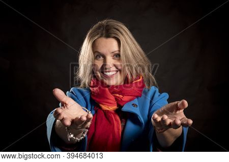 Cheerful 40 Years Old Woman In Blue Coat And Red Kerchief Emotional Portrait